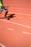 Kid runing on track in the Stadium Royalty Free Stock Images
