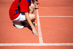 Kid runing on track in the Stadium.  Stock Photos