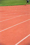 Kid runing on track in the Stadium Stock Image