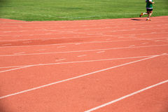 Kid runing on track in the Stadium Royalty Free Stock Photos