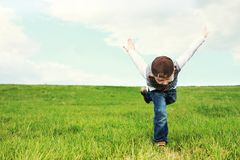Kid running on grass stock images