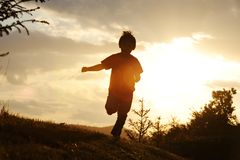 Kid running on meadow Royalty Free Stock Image
