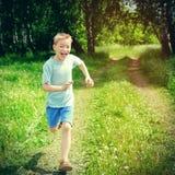 Kid running outdoor Stock Photo