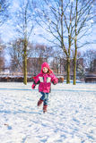 Kid running in a park Stock Images
