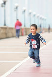 Kid running with smile on his face. The baby boy is runing with similing on his face Stock Image