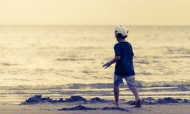 Kid running to a sand beach Royalty Free Stock Photography