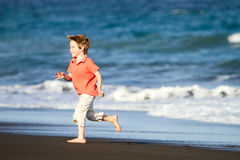 Kid runs on the beach Royalty Free Stock Photography