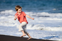 Kid Runs On The Beach Royalty Free Stock Photo