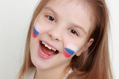 Kid and Russian flag. Smiley happy little girl with Russian flag symbol stock images