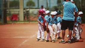 Kid`s baseball team with coaches right before a game