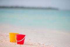 Kid's beach toys on white sand. Buckets and blades for kids on the white sandy beach after children's games Stock Image