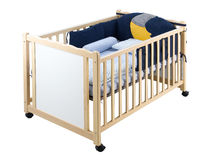 Kid's bed or baby cot Stock Photo