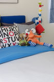 Kid's bedroom with colorful pillows and dolls. At home royalty free stock images