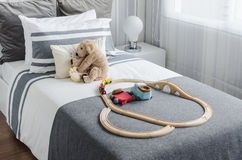 Kid's bedroom with dolls on bed in black and white style Stock Images