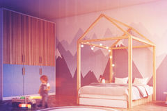 Kid s bedroom interior, side view, boy. Boy s bedroom interior with a white wall, a mountain wall paper, a house like bed and a cabinet, toys. Corner, boy. 3d Stock Photo