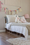 Kid's bedroom with pillows and dolls on bed Royalty Free Stock Image