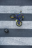 Kid`s bike lying on the road after car accident Royalty Free Stock Photography