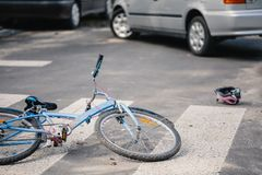 Kid`s bike on a pedestrian crossing hit by drunk car driver. Concept photo stock image