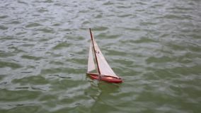 Kid`s boat floating in city fountain stock footage