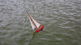 Kid`s boat floating in city fountain stock video footage