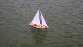 Kid`s boat floating in city fountain stock video