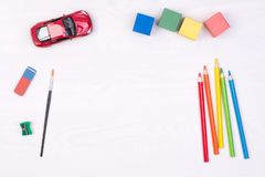 Kid`s desk with colorful pencils and toys Stock Photo