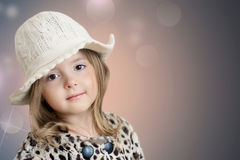 Kid's fashion background. Beautiful little girl closeup. Stock Photography