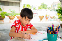 Kid's hand drawing picture Stock Images
