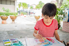 Kid's hand drawing picture Stock Photography
