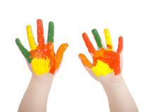 Kid's hands painted in bright colors isolated Royalty Free Stock Photos