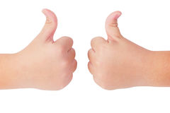 Kid's hands showing thumbs up gesture Royalty Free Stock Image