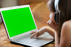 Kid's Hands typing keyboard on desk wood. Royalty Free Stock Image