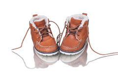 Kid's leather shoes on white background Stock Photos