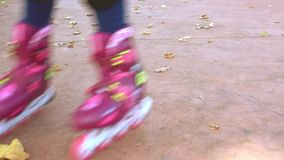 Kid`s legs in inline skates. Slow motion stock video footage