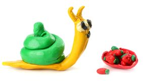 Kid`s modelling clay snail isolated on white background Stock Images