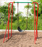 Kid's Modern Red Playground Swing Stock Photos