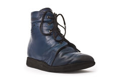 Kid's orthopedic footwear. Old blue kid's orthopedic footwear isolated on white stock photography