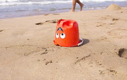 A kid`s pail in the sand on the seashore Royalty Free Stock Photography