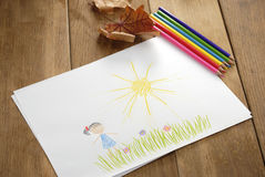 Kid's picture on the wooden table Stock Images