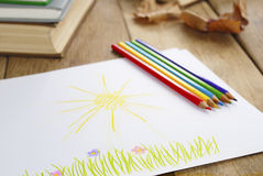 Kid's picture on the wooden table Royalty Free Stock Photography