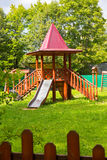 Kid's playground outdoors tower green lawn Royalty Free Stock Images