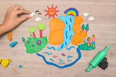 Kid`s playing and creating toys from play dough. And Molding clay Royalty Free Stock Photos