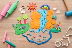 Play dough and Molding clay. Kid`s playing and creating toys from play dough and Molding clay Royalty Free Stock Images