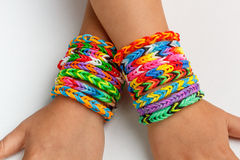 A kid's with rainbow color loom band Royalty Free Stock Images