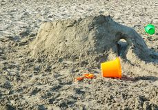 Kid`s Sand Castle on Beach. With colored buckets stock images
