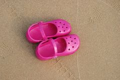 Kid's sandals. Left in the beach Stock Images