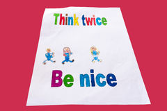 Kid's school work. Think twice, be nice...child's school work isolated on red background Stock Photography