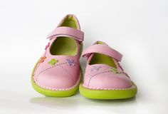 Kid's shoes. On natural white background with small reflection Stock Photos