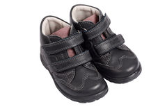 Kid's shoes from the black leather Royalty Free Stock Photo