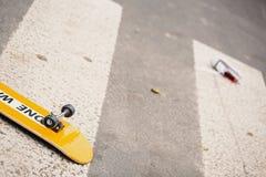 Kid`s skateboard on pedestrian crossing after dangerous traffic. Incident stock image